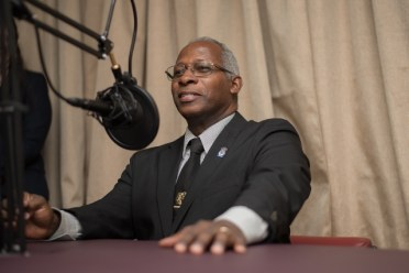 Chairman of the Guyana National Broadcasting Authority (GNBA), Leslie Sobers tries out the equipment in the studio.