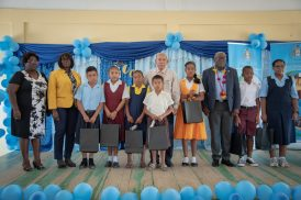 Some of the top perfomrers for Region 8 along with Minister of Social Cohesion, Hon. Dr. George Norton [centre], Chief Education Officer (CEO), Dr. Marcel Hutson [third from right] and Regional Education Officer (REdO) Penelope McIntosh and Assistant Chief Education Officer (Primary), Carol Benn [left and second from left respectively]