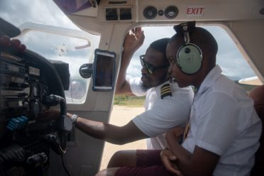 Roraima Airways Pilot Rasheed Dey explains the various aircrsft's controls to the young Nevin David McLean