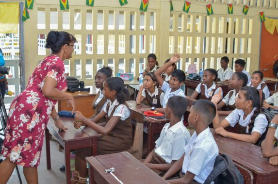 Deputy Headmistress of CV Nunes Primary School, Bindawattie Ketwaru attending to her students