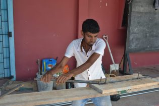 One of the workers currently rehabilitating the Queenstown Community Centre in Essequibo, Region 2.