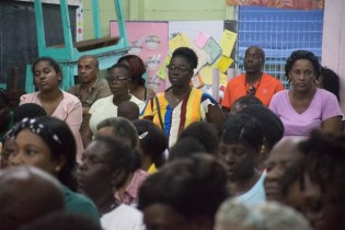 Scenes from the community meeting held at Plaisance Primary School.