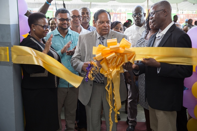 Hon. Moses Nagamootoo, Prime Minister of Guyana cuts the ribbon to declare open the new Central Supplies Unit Medical Bond in Kingston. Looking on is Minister of Public Health, Hon. Volda Lawrence [left] and His Worship the Mayor of Georgetown, Ubraj Narine [second from left].