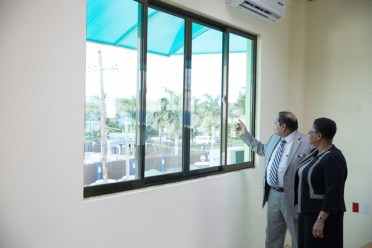 Hon. Moses Nagamootoo, Prime Minister of Guyana and Minister of Public Health, Hon. Volda Lawrence inspecting the bond.