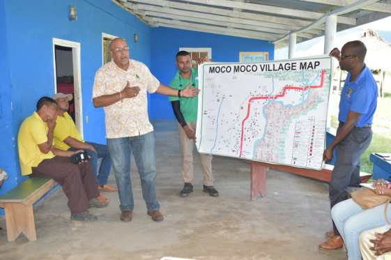 Dr. Van West-Charles points to map which was designed by Moco Moco Villager & printed through GWI, as he highlights that it will help in the laying of pipelines
