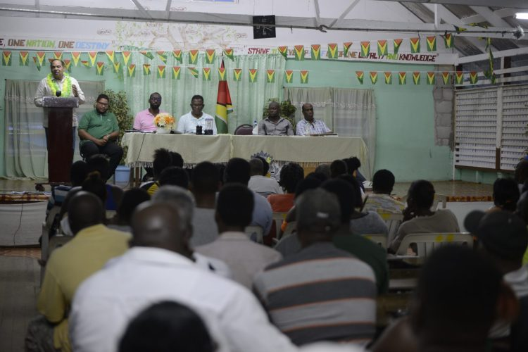 Prime Minister, Moses Nagamootoo speaking with residents of Mahaica