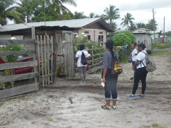 GECOM field officers being welcomed into a home by a resident of South Amelia's Ward