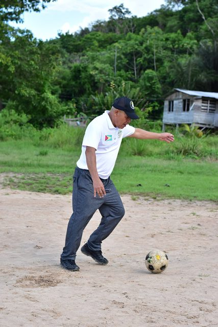 Minister of Social Cohesion, with responsibility for Culture, Youth and Sport, Hon. Dr. George Norton about testing his legs on the football field.