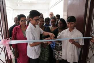 The cutting of the ribbon done by the two lone males of the first batch attending Annex II.