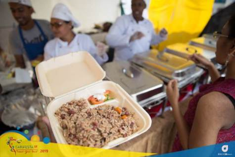Guyanese 'Cook-up rice' - the local dish being purchased by a patron at the CARIFEST XIV 'Grand Market'.