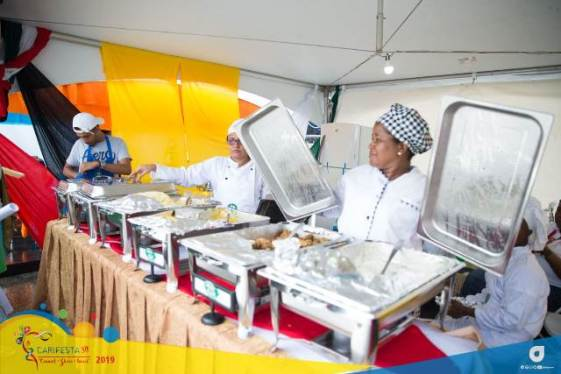 The team from the Carnegie School of Home Economics (CSHE) operating the booth at CARIFEST XIV 'Grand Market'.