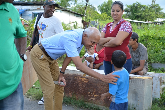 Minister of Communities, Hon. Ronald Bulkan meets residents during a walkabout at Betsy Ground.