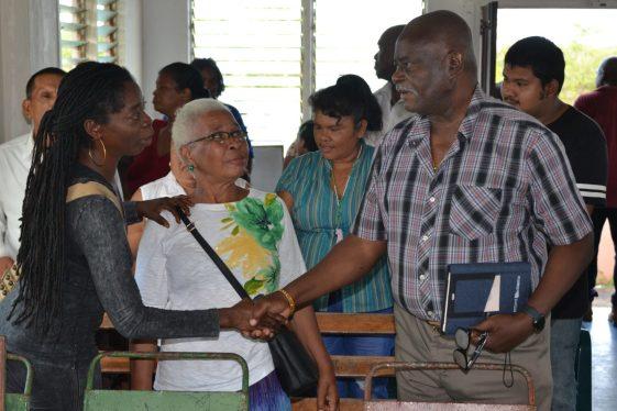 Minister of Citizenship, Hon. Winston Felix greets residents of Long Creek on Sunday