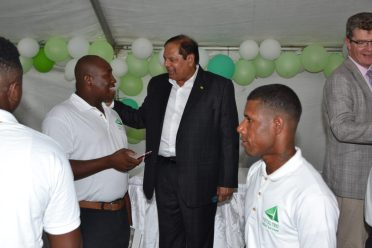 Prime Minister, Hon. Moses Nagamootoo interacting with some of the graduates