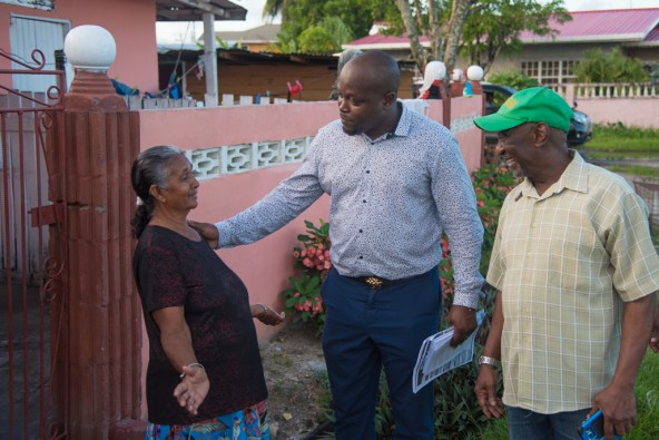 Minister within the Ministry of Social Protection, Hon. Keith Scott and councillors during the walkabout in the community of West Ruimveldt.