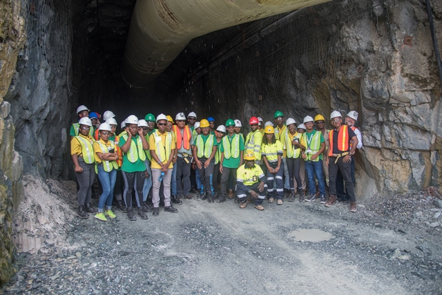 Youth in Natural Resources (YNR) Apprentices in front of the first underground exploration tunnel currently being explored by AGM.