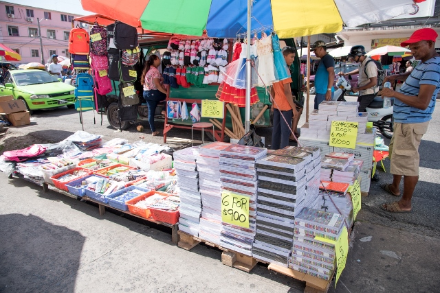 Vendor Naresh Partab, with some of his school supplies on display.