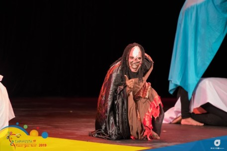 Scene from the Guyana National Drama Company's performance at Drama Night at SAPA in San Fernando, Trinidad during CARIFESTA XIV.