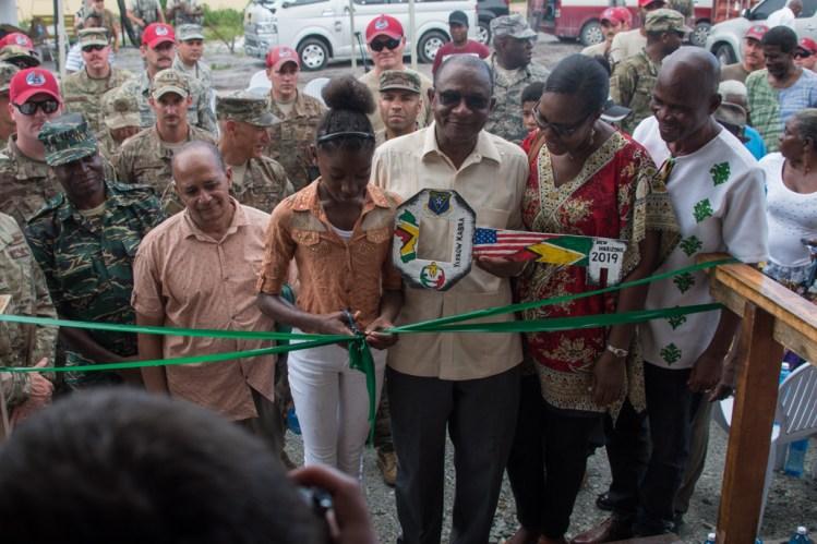 Elan Dejong cuts the ribbon to the newly established community centre at Yarrowkabra on the Soesdyke-Linden Highway
