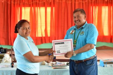 A member of the Parishara Organic Food Processors group receiving her certificate from Minister of Indigenous Peoples' Affairs, Hon. Sydney Allicock