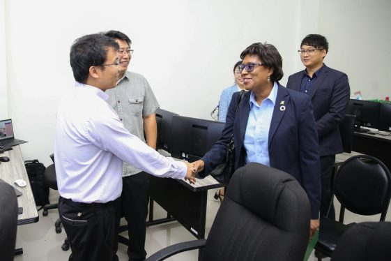 Minister of Public Telecommunications, Hon. Catherine Hughes interacts with a partner from the Chinese Government at the launch of the Intelligent Surveillance System