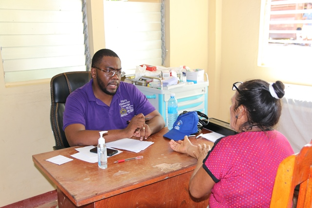 One of the doctors on the outreach team meeting with a resident