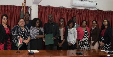 Minister of Foreign Affairs, Hon. Dr. Karen Cummings and Deputy Permanent Secretary, MOPH Glendon Fogenay along with representatives from the Department of the Environment, the Office of Climate Change and the Ministries of Foreign Affairs and Public Health.