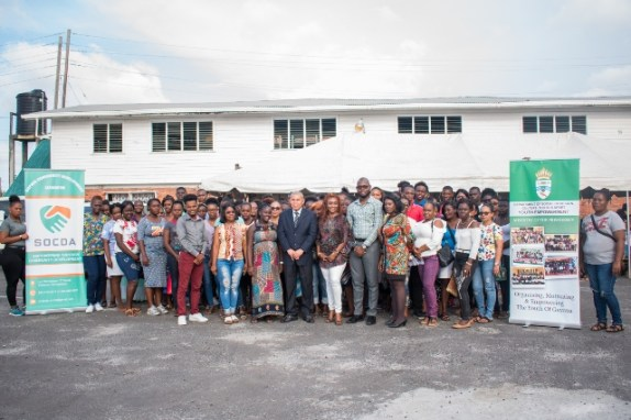 Minster of Social Cohesion, Hon. Dr. George Norton [centre] with members of SOCDA and the students who will be attending the Sophia Night School.