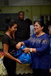 Sita Nagamootoo, wife of Prime Minister, Hon. Moses Nagamootoo, gifting a hamper to a Blairmont resident.