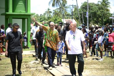 His Excellency, President David Granger waves to celebrants as he enters the Number 53 ground