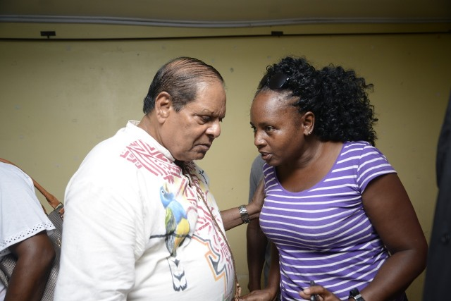 Prime Minister, Hon. Moses Nagamootooo listens to a resident.