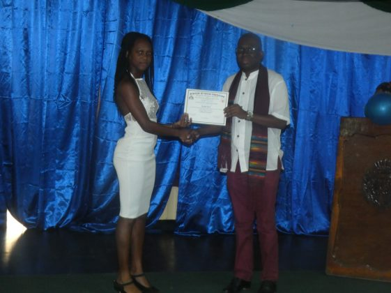 Chief Executive Officer (ag) of BIT, Richard Maughn presents a certificate to a graduate