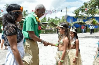 President David Granger meets children of St. Cuthbert's Mission on his arrival in the village this morning. Toshao Ms. Beverly Clenkian is also pictured, first, left.