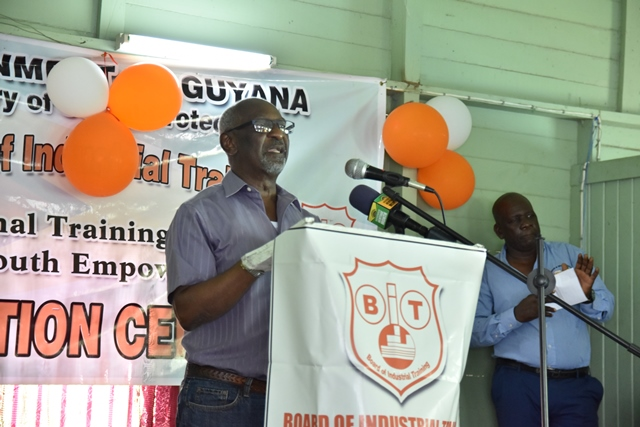 Minister within the Ministry of Social Protection, Keith Scott addressing Baracara residents and the graduates of a recent boat building training programme facilitated by the Board of Industrial Training (BIT)
