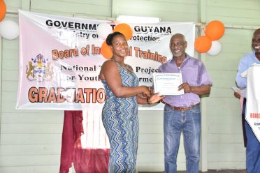 Cassandra Amsterdam receives her certificate from Minister within the Ministry of Social Protection Keith Scott