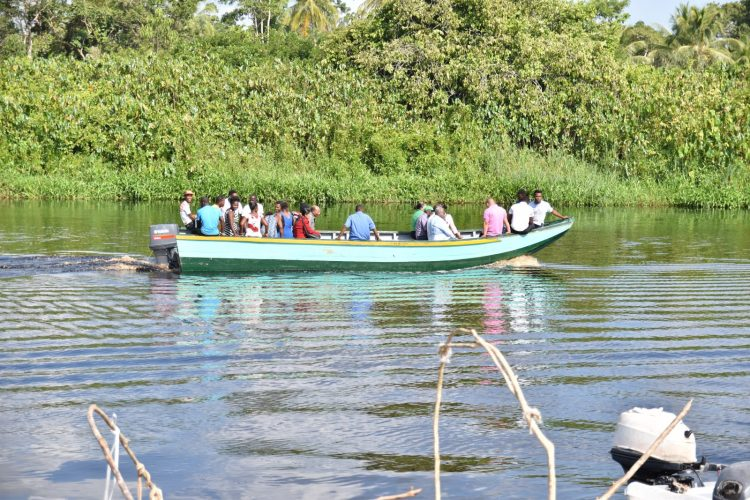 Minister within the Ministry of Social Protection, Keith Scott. CEO of BIT Richard Maughn, BIT Board Chairman, Clinton Williams, officials from the agency and regional representatives join some of the Baracara residents for the boat's first test ride