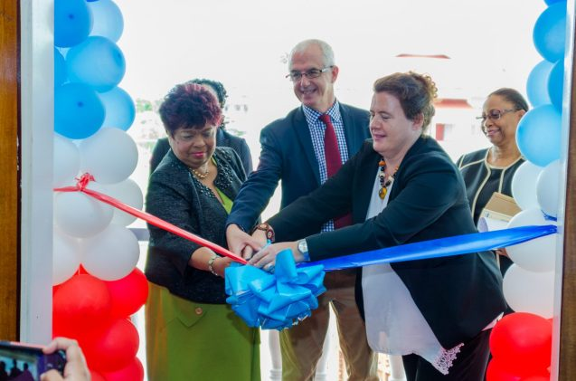 Minister of Social Protection, Hon. Amna Ally assists UNICEF's country representative, Sylvie Fouet to cut the ribbon.