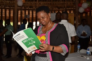 Minister of Public Health, Hon. Volda Lawrence takes a closer look of the new National Sexual Reproductive Health document.