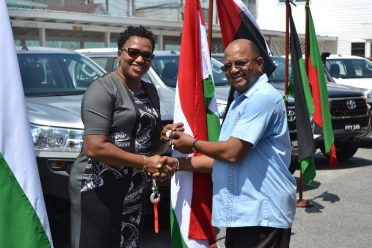 Regional Executive Officer of Region 9, Upper Takutu-Upper Essequibo, Carl Parker receiving the keys to the vehicles from Minister within the Ministry of Communities, Annette Ferguson