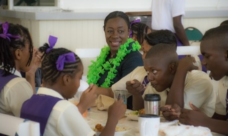 Minister of Education, Hon. Dr. Nicolette Henry having lunch with the students of President's College.