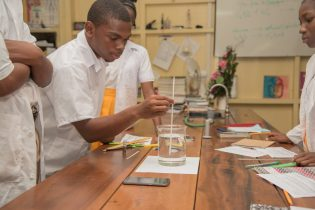 Grade 10 student, Kymani Maloney during an experiment in the science laboratory