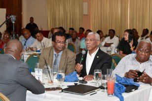 President David Granger responds to questions posed by some members of the business community. Also photographed are Minister of Public Security, Mr. Khemraj Ramjattan, (left of President); Mr. Clinton Williams, President of the GMSA and Minister of Public Infrastructure, Mr. David Patterson (backing camera).
