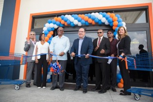 Minister of Finance, Hon. Winston Jordan, Chairman of Massy's Integrated Business Unit David Affronso, and Minister of Business, Hon. Hemraj Rajkumar, flanked by Massy executives at the opening of Massy Store Mega, at the MovieTowne Complex Turkeyen, Greater Georgetown.