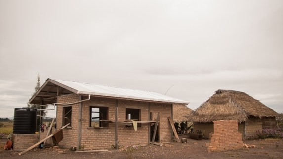 One of the two-bedroom clay brick home under construction in the village of Semonie