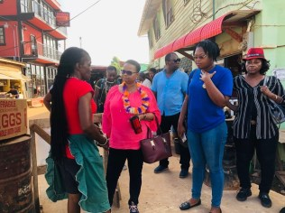 Minister of Public Health, Hon. Volda Lawrence interacts with a vendor in the Port Kaituma Market Square.