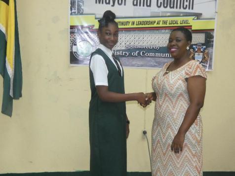 Linden Mayor, Her Worship Waneka Arrindell congratulates newly appointed junior Mayor of Linden, Janae Bristol