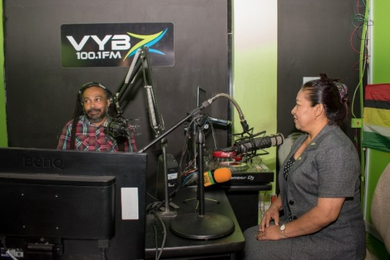 [In the photo, from left to right] Radio Announcer, Malcom Ferreira and Minister of State, Hon. Dawn Hastings-Williams in the studio of NCN's Vybz 100.1 FM.