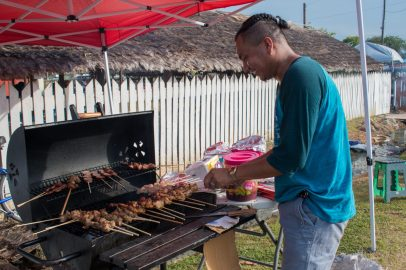 Ray France carefully grilling a variety of meats