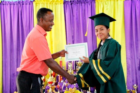 Students receiving their certificates yesterday