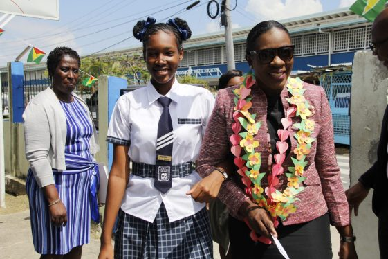 Minister of Education, Hon. Dr. Nicolette Henry with a student of the North Georgetown Secondary School